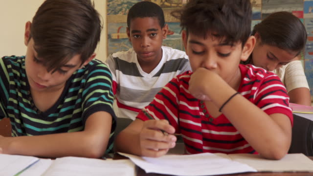 Friends-Cheating-During-Test-At-School-And-Students-Studying