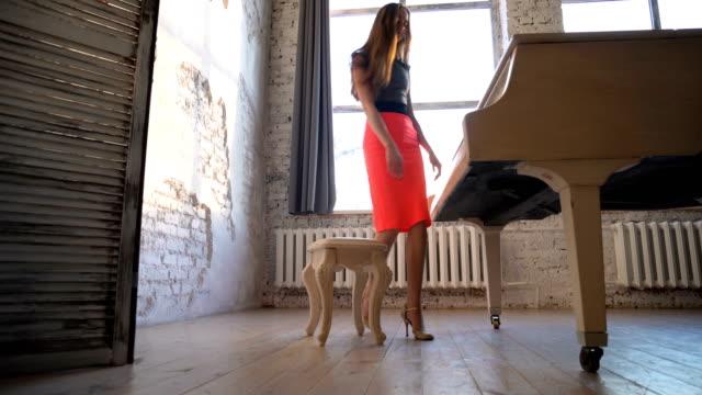 Beautiful-girl-playing-on-the-grand-piano-