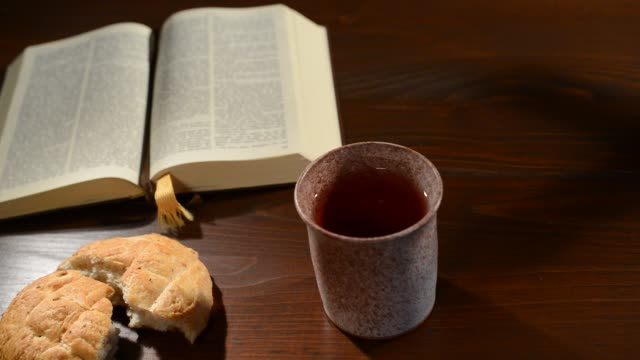 Bible-with-Chalice-and-Bread-Panning