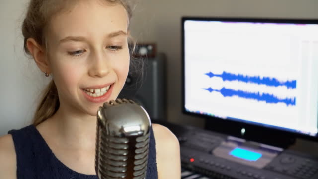 Little-girl-singing-a-song-in-home-recording-studio-