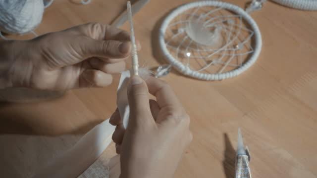 Female-Hands-Creating-Dream-Catcher-Closeup
