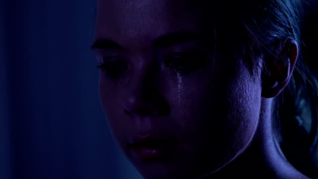 Portrait-of-depressed-female-crying-about-life-troubles-psychological-trauma