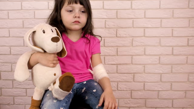 Sad-child-with-a-soft-toy-