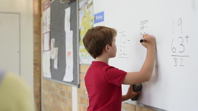 School-boy-solving-math-problem
