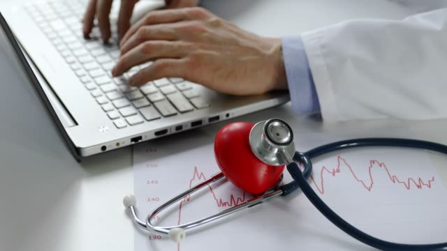 cardiology---doctor-cardiologist-working-on-laptop-computer-in-office