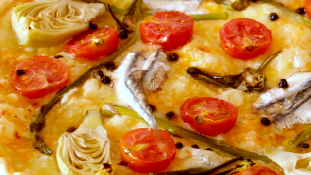 Pizza-with-anchovies-artichokes-cheese-and-sun-dried-tomatoes