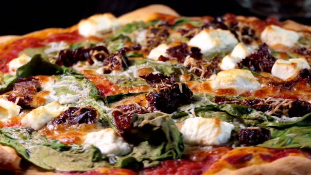 Pizza-with-spinache-dried-tomatoes-and-feta-cheese-Spin-shot-