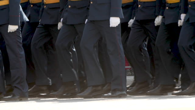 People-of-military-army-walking-in-boots-closeup-in-the-parade-of-city-square-