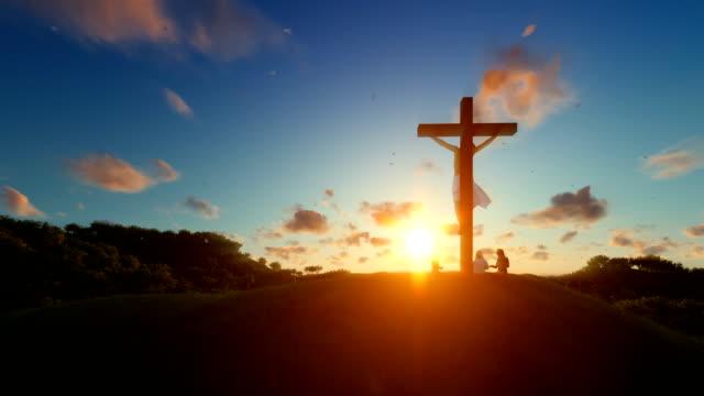 Jesús-en-cruz-contra-la-hermosa-puesta-de-sol-creyentes-orando