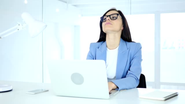 Young-Businesswoman-with-Headache,-Tension-and-Stress
