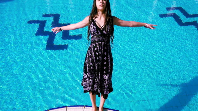 Young-girl-in-dress-falling-to-swimming-pool