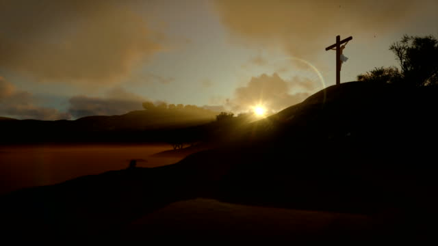 Christian-woman-praying-at-Jesus-cross-sunrise-4K