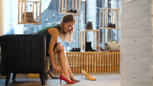 young-woman-trying-heeled-shoes-at-store
