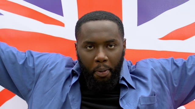 Angry-black-man-raising-Great-Britain-flag-brexit-protest-migration-crisis