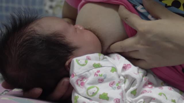 Baby-sucks-mother-s-breast-closeup