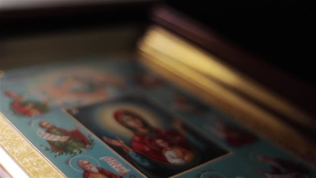 Icon-image-of-Virgin-Mary-in-St-Nicholas-Orthodox-Cathedral-in-Nice-France-macro-close-up-light-moving-Framed-painting-of-Mother-of-God-in-Orans-position-with-Child-Jesus-attended-by-saints