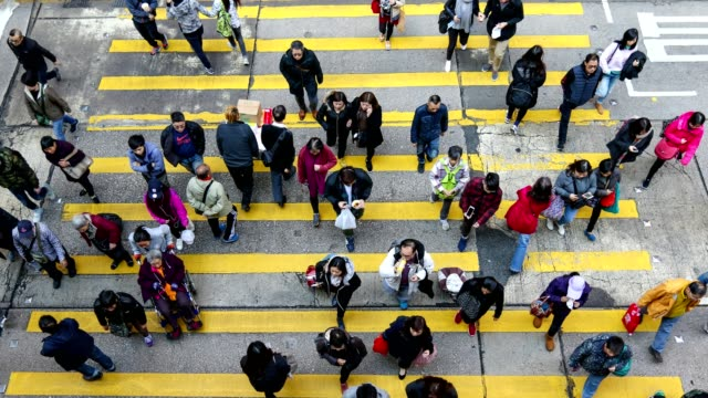 Busy-pedestrian-and-car-crossing-at-Hong-Kong---time-lapse