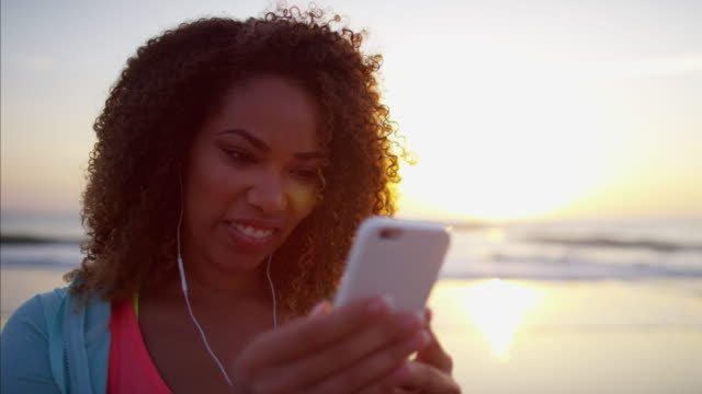 African-American-female-texting-with-smart-phone-technology