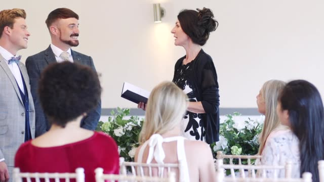 Male-Couple-Exchanging-Vows