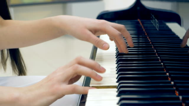 The-close-up-of-the-musician-hands-playing-the-piano-No-face-4K-