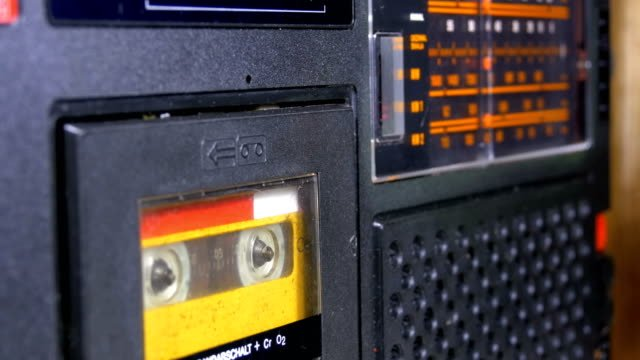 The-Vintage-Yellow-Audio-Cassette-in-the-Old-Tape-Recorder-Rotates