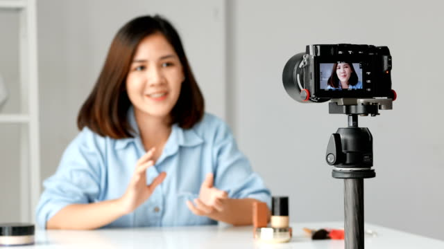 Young-asian-woman-beauty-fashion-blogger-recording-video-Presen-her-product-shooting-on-camera-