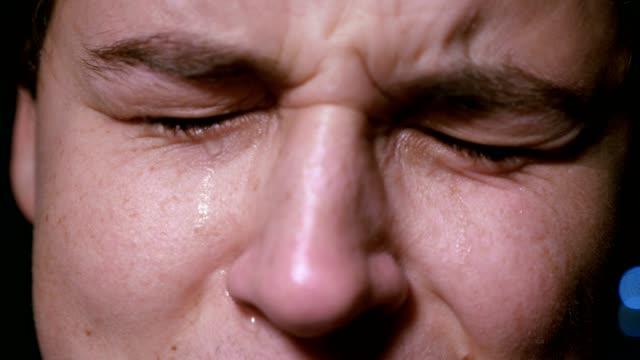 depressed-young-man-crying---macro