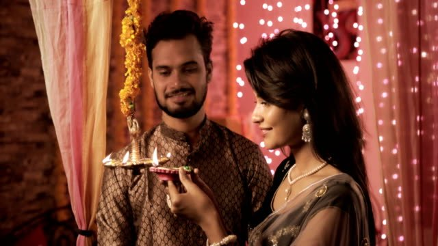 Newly-wed-bride-and-groom-in-a-house-interior-decorated-with-lights-and-flowers-