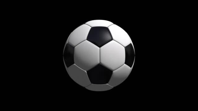 Animación-de-fútbol-de-balón-de-fútbol-sobre-fondo-negro