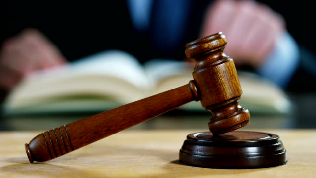 phone-of-lawer-or-notaries-with-hammer-as-a-judge-for-the-insurance-compensation-or-criminal-cases-