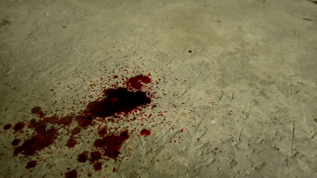 Blood-dripping-down-into-cement-floor