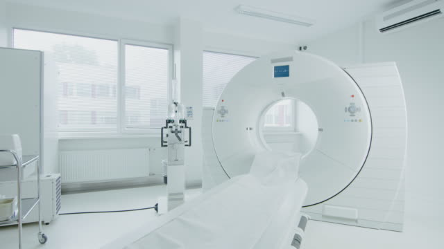 Medical-CT-or-MRI-or-PET-Scan-Standing-in-the-Modern-Hospital-Laboratory-Technologically-Advanced-and-Functional-Mediсal-Equipment-in-a-Clean-White-Room-Slowly-Moving-Side-Shot-