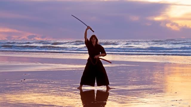 Samurai-woman-at-the-beach-at-sunset