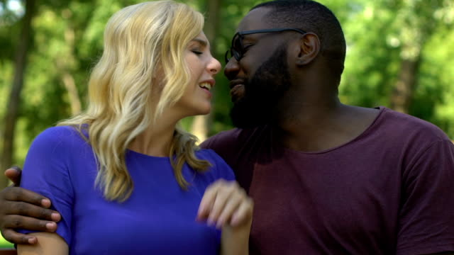 Beautiful-female-refusing-afro-american-man-trying-to-kiss-her-friend-zone