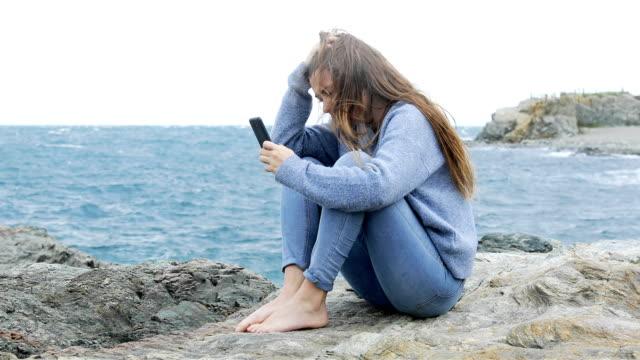 Sad-teen-complaining-after-reading-phone-message