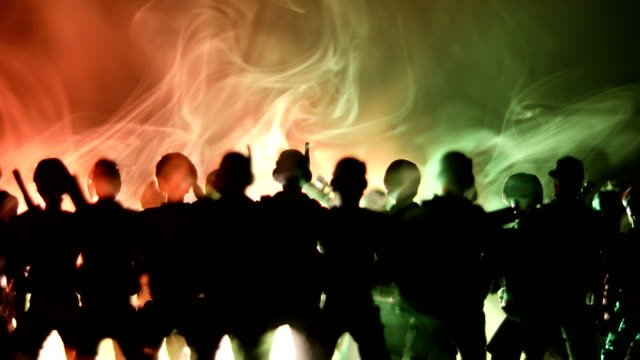 Anti-riot-police-give-signal-to-be-ready-Government-power-concept-Police-in-action-Smoke-on-a-dark-background-with-lights-Blue-red-flashing-sirens-Dictatorship-power