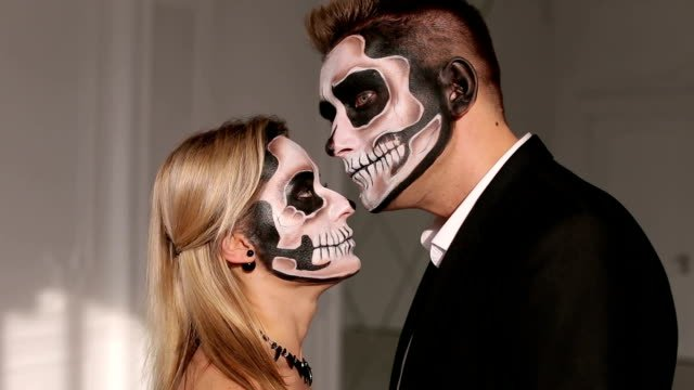 Portrait-of-a-young-couple-in-the-Halloween-mask-Close-up-