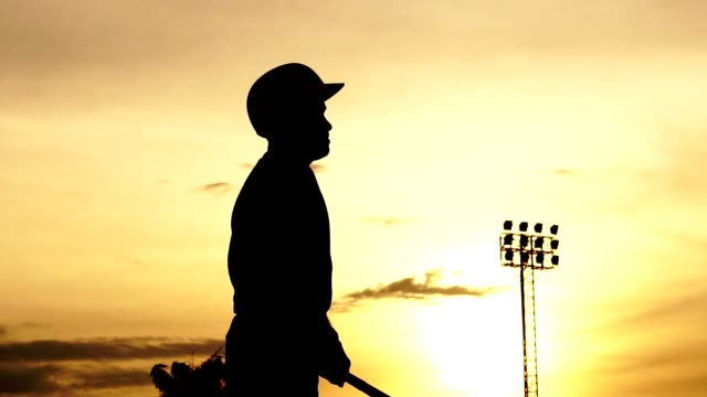 Silhouette-baseball-player-holding-a-baseball-bat-to-hit-the-ball-drills