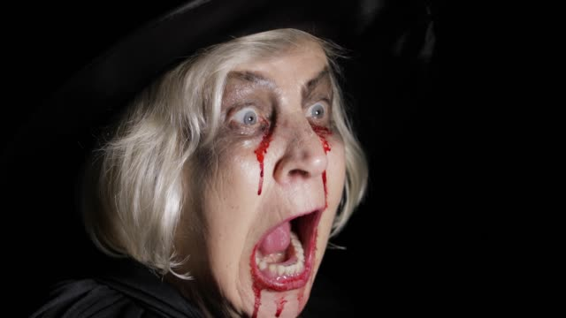 Old-witch-Halloween-makeup-Elderly-woman-portrait-with-blood-on-her-face-