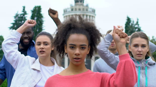 Young-activists-raising-hands-chanting-for-human-rights-call-for-democracy