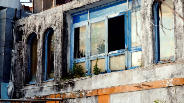 Architecture-of-Greece-Broken-window-in-building-is-an-old-abandoned-hotel-4K