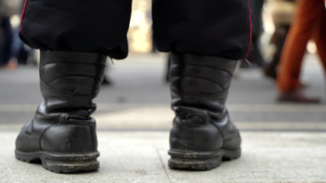 Concept-power-and-people-police-and-demonstrators-Demonstrators-through-police-boots