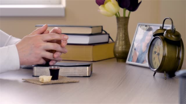 Young-Christian-woman-taking-communion