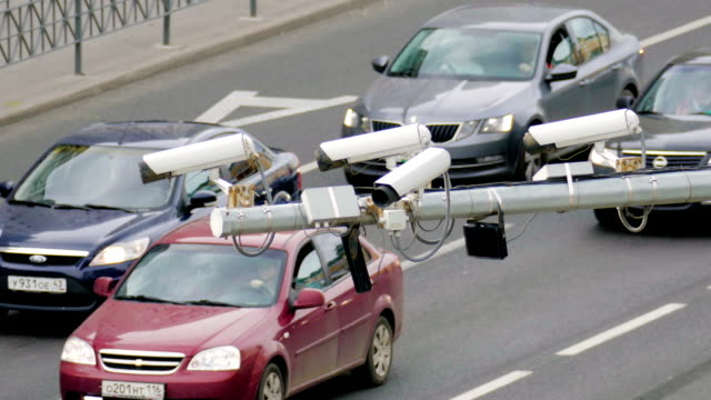 Closeup-of-four-traffic-security-camera-surveillance-CCTV-on-the-road-in-the-big-city