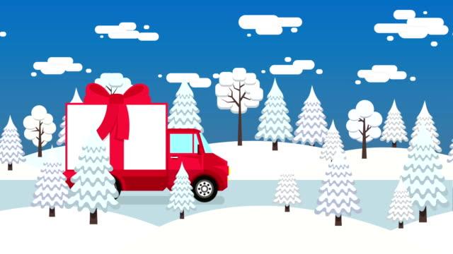 Camión-con-caja-de-regalo-atada-con-una-cinta-roja