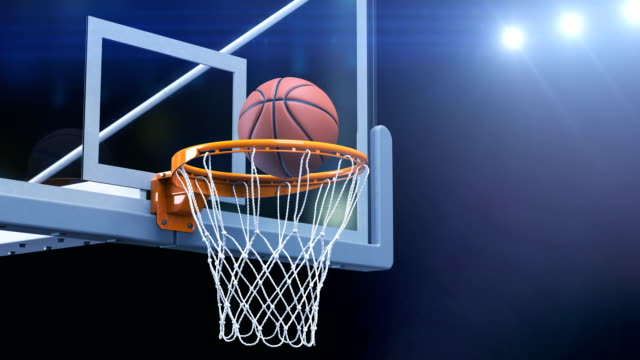 Beautiful-Basketball-Ball-Hits-Basket-Net-Slow-Motion-Close-up-Camera-Fly-Ball-Flies-Spinning-into-Basketball-Hoop-with-Blue-Stadium-Lights-Sport-Concept-3d-Animation