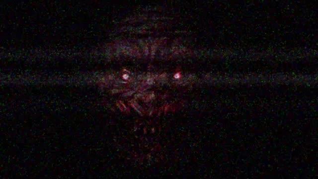 Scary-zombie-face-on-black-background-TV-damage