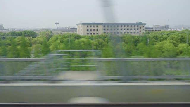 Passing-Landscape-Asian-Bullet-Train-High-Speed-Transportation-Travel-Greenery