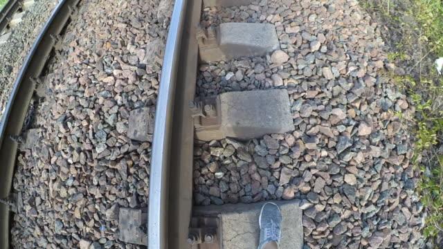 A-girl-steps-on-railroad-sleepers