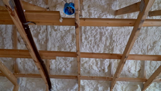 Interior-of-the-frame-house-in-construction-of-termal-insulation-installing-at-the-attic-the-roof